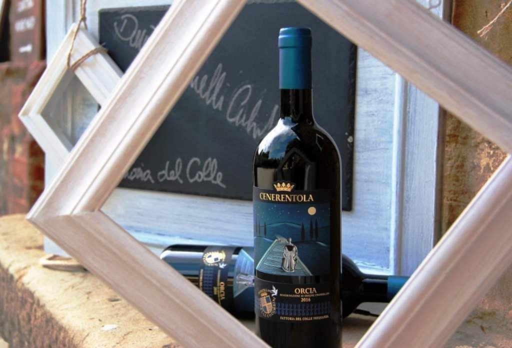 Bottle of Cenerentola Doc wine in a frame of a painting
