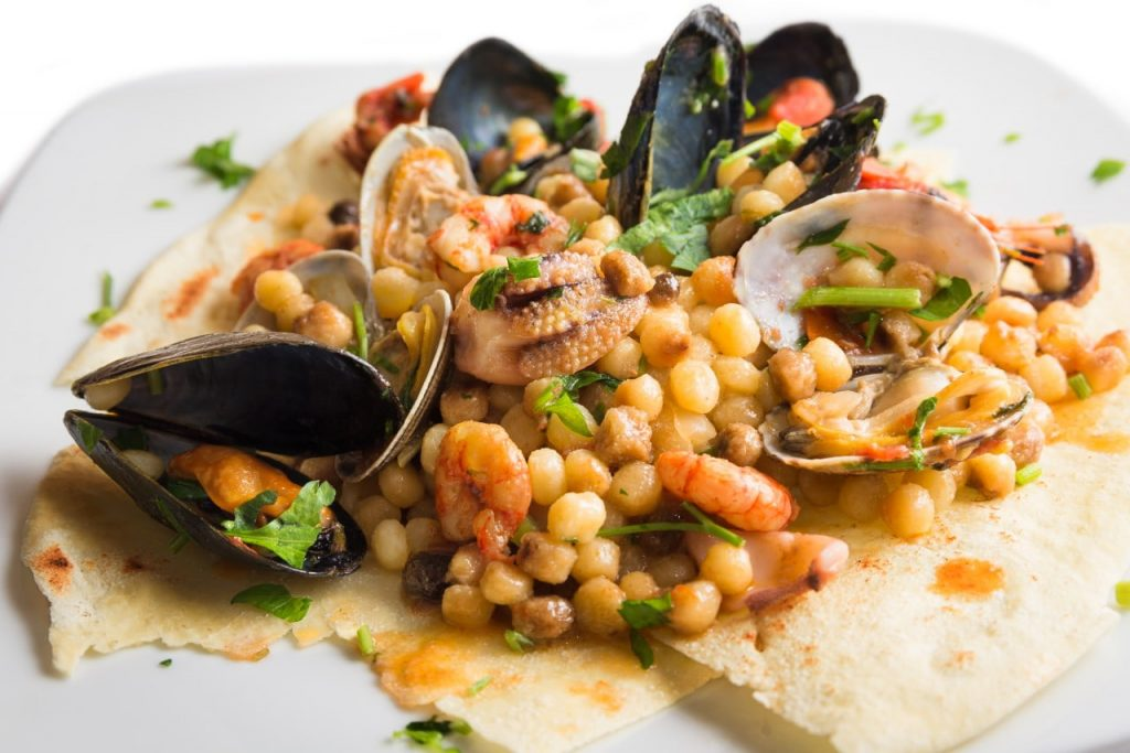 typical paella algherese seafood and fregula