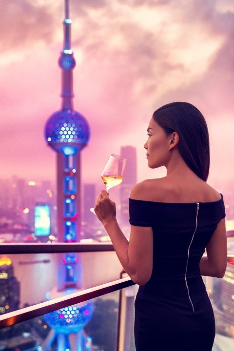 young woman drinking Shanghai terrace